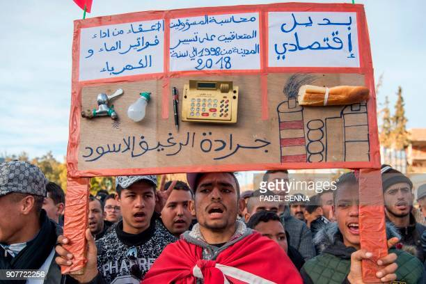 Moroccans shout slogans and carry placards during a demonstration against economic marginalisation on January 20 in the northeastern city of Jerada...