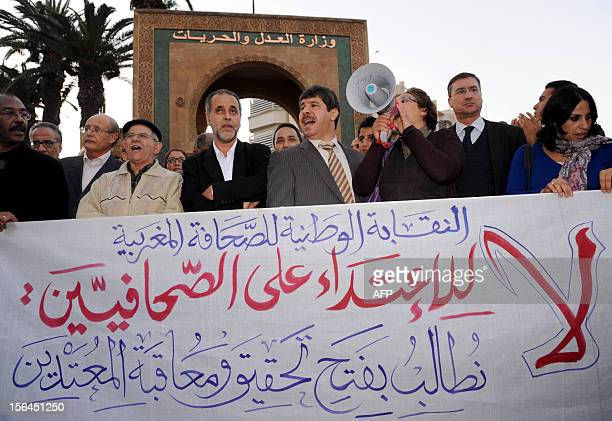 Moroccans take part in a demonstration in front the ministry of justice to protest against the violence from the police on journalists and...