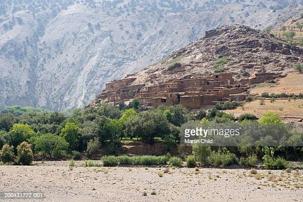 Morocco, Atlas mountains, Berber village at foothill of mountains