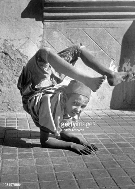 Morocco - boy at an artistic performance in Tetuan, Morocco, ca.1954.