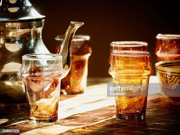 morocco, casablanca, tea pot and tea glasses in a teahouse - casablanca photos et images de collection