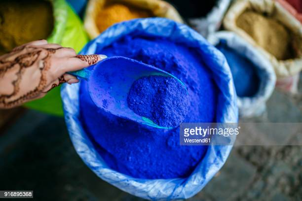 morocco, chefchaouen, woman's hand painted with henna tattoo holding ladle with blue pigments - chefchaouen fotografías e imágenes de stock