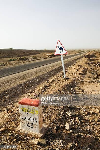 Morocco, Draa Valley-ZAGORA, Camel Crossing sign & mileage marker, Draa Valley Road