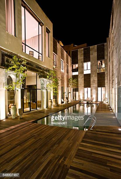 Morocco, Fes, Hotel Riad Fes, courtyard with swimming pool by night