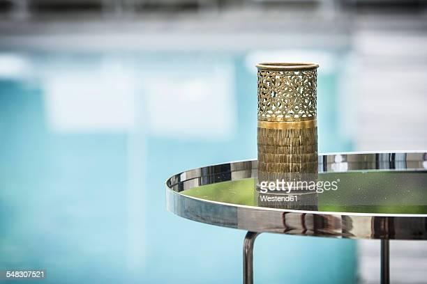 Morocco, Fes, Hotel Riad Fes, tea light holder on side table near the pool