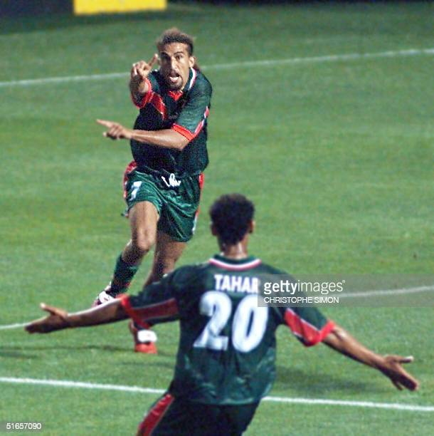 Morocco forward Moustafa El Hadji jubilates after scoring the first goal 10 June at the Stade de la Mosson in Montpellier during their 1998 Soccer...