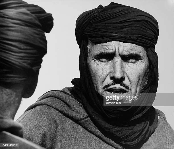 Morocco Guelimine Tuareg on camel market portrait of a man with turban