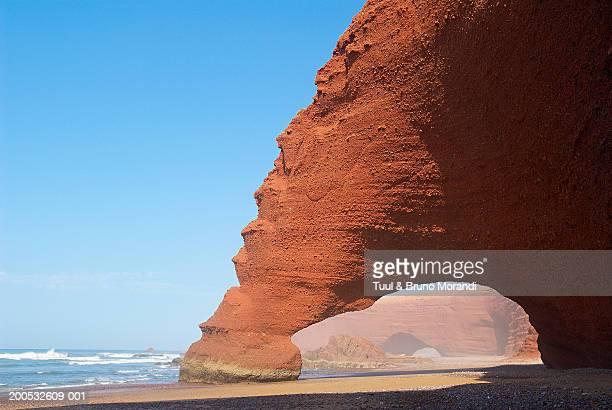 morocco, legzira, rock formation on beach - agadir photos et images de collection