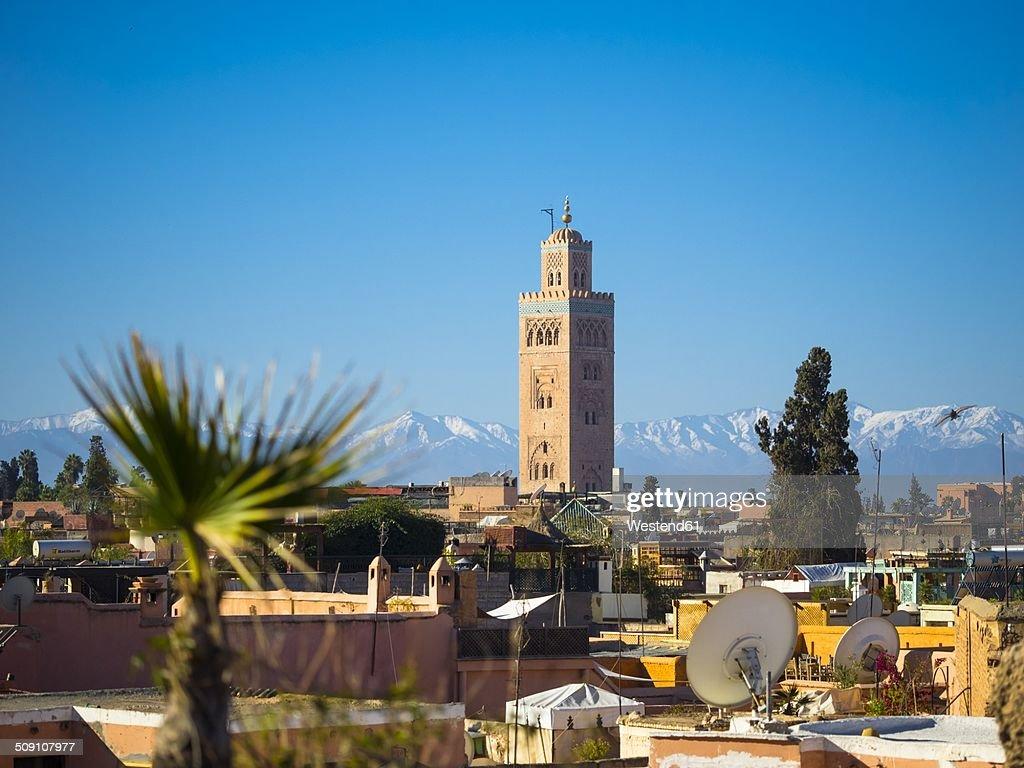 Morocco, Marrakech, Koutoubia Mosque with Atlas mountains in background : Stock Photo