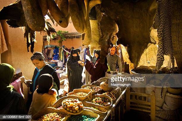 Morocco, Marrakech, people standing in souk