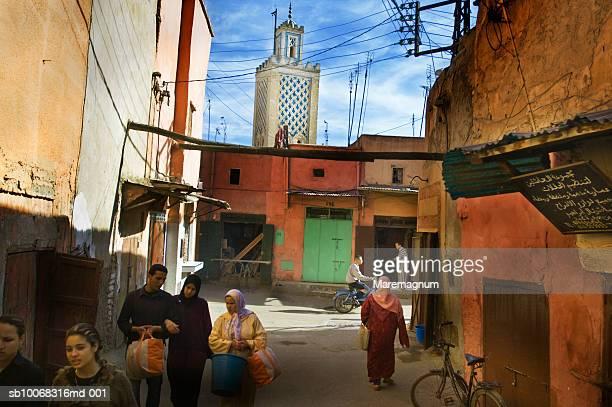Morocco, Marrakech, people walking on streets in Medina