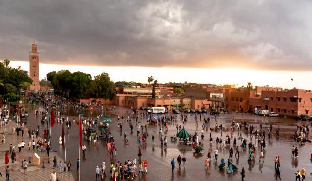 Morocco, Marrakesh, Jemaa el-Fnaa square after the rain at twilight