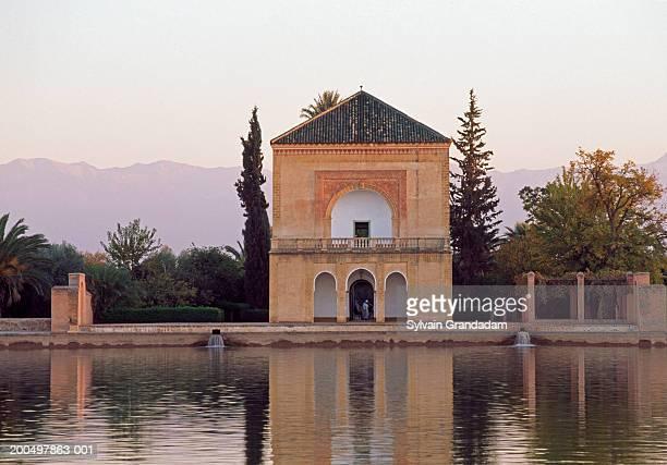 Morocco, Marrakesh, Menara Gardens, reservoir and pavilion at dusk