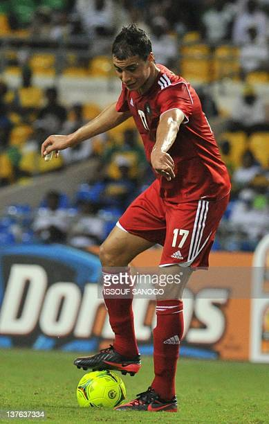 Morocco national football team striker Marouane Chamakh controls the ball during the match against Tunisia at the Stade de l'Amitie on January 23...