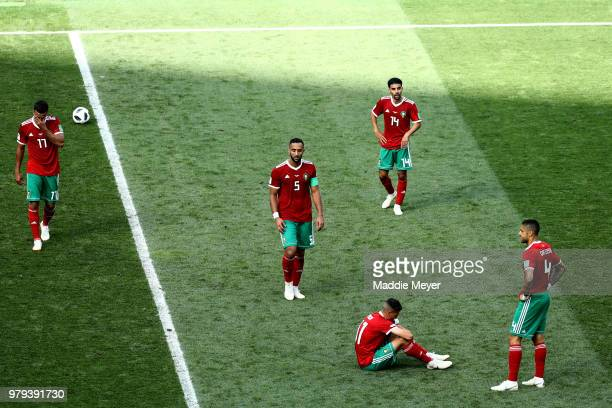 Morocco players show their dejection following the 2018 FIFA World Cup Russia group B match between Portugal and Morocco at Luzhniki Stadium on June...