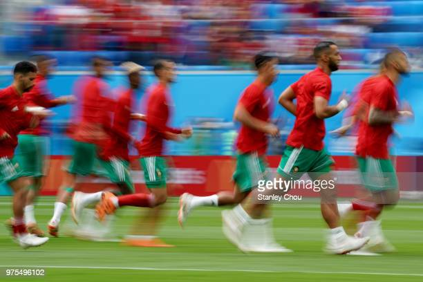 Morocco players warm up before kick off during the 2018 FIFA World Cup Russia group B match between Morocco and Iran at Saint Petersburg Stadium on...