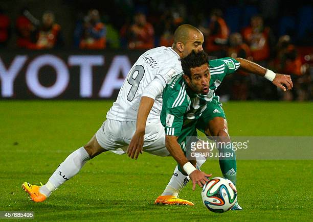 Morocco Raja Casablanca's defender Adil Karrouchy fights for the ball against Brazil Atletico Mineiro's forward Diego Tardelli during their semifinal...