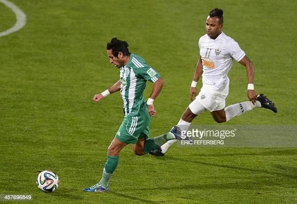 Morocco Raja Casablanca's defender Adil Karrouchy fights for the ball against Brazil Atletico Mineiro's forward Fernandinho during their semifinal...