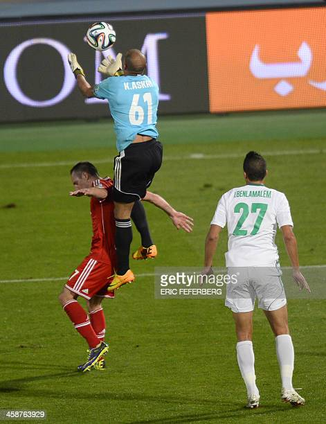 Morocco Raja Casablanca's goalkeeper Khalid Askri stops the ball over Bayern Munich's French midfielder Franck Ribery during their 2013 FIFA Club...