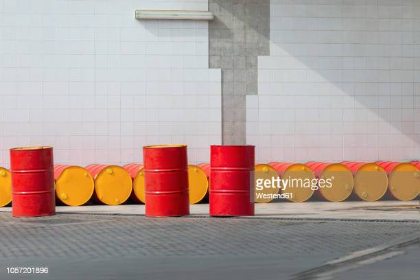 morocco, row of oil drums - stahlfass stock-fotos und bilder