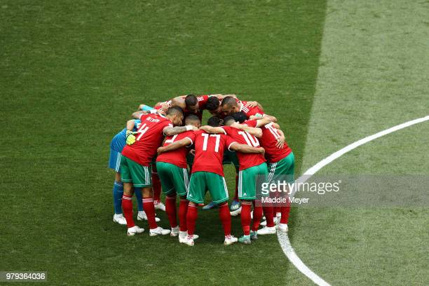 Morocco team huddle prior to the 2018 FIFA World Cup Russia group B match between Portugal and Morocco at Luzhniki Stadium on June 20 2018 in Moscow...