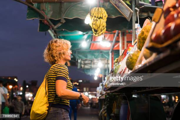 Morocco, woman at a market stall