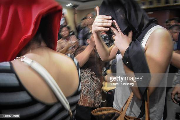 Morocco Womens Suspected Of Working As Prostitutes Cover Their Faces After Their Arrest At An Immigration