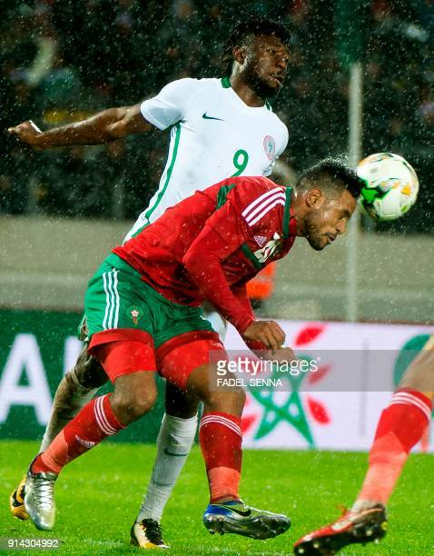 Morocco's Abdjalil Jbira vies for the ball with the Nigeria's Antony Okpotu during the African Nations Championship football final between Morocco...