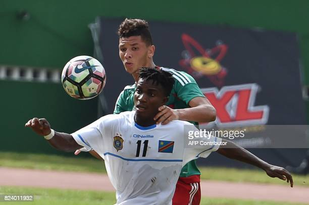 Morocco's Achraf Dari vies for the ball with Congo's Nathan Nsumbuka during the semifinal football match between Morroco and the Democratic Republic...