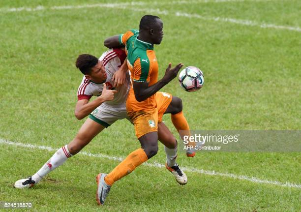 Morocco's Achraf Dari vies with Ivory Coast's Thierry Martial Kassi after winning the 8th Francophonie Games final football match between Ivory Coast...