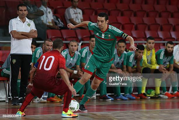 Morocco's Adil Habil with Portugal's Ricardinho in action during the Futsal International Friendly match between Portugal and Morocco at Pavilhao...