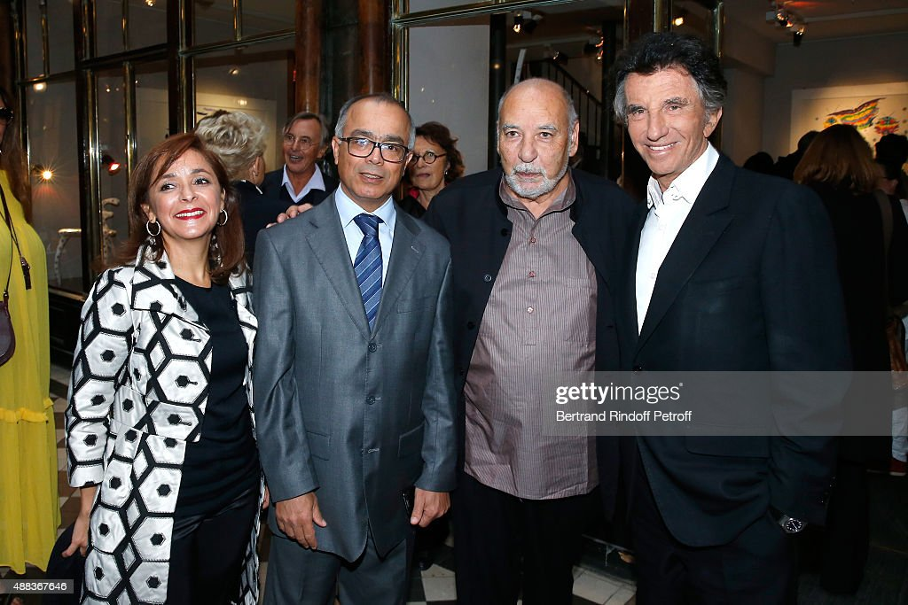 Morocco's ambassador in France Chakib Benmoussa with his wife, Writer Tahar Ben Jelloun and Jack Lang attend the 'Paintings Poems from Tahar Ben Jelloun - Furniture Scriptures from C.Saccomanno & O.Dayot' : Press Preview at Galerie du Passage on September 15, 2015 in Paris, France.