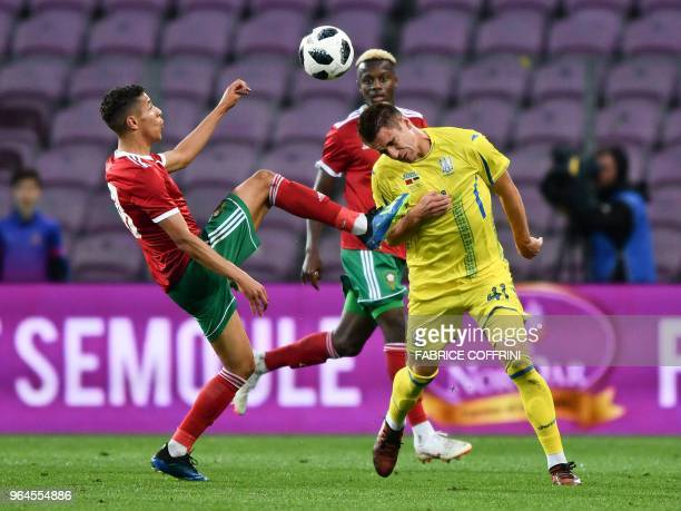Morocco's Amine Harit and Ukraine's forward Artem Besyedin vies for the ball during the friendly football match between Morocco and Ukraine at the...