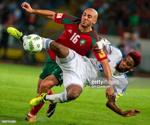 Morocco's Amrabet Noureddine vies for the ball with Gabon's Wachter Claude during their FIFA world Cup 2018 Group C football match between Morocco...