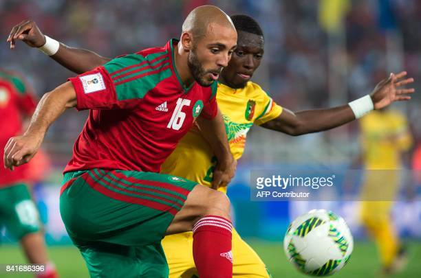 Morocco's Amrabet Noureddine vies for the ball with Mali's Hamari Traore during the Morocco vs Mali qualification match for the Fifa World Cup Russia...