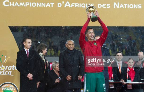 Morocco's Badr Banoun holds the trophy after Morocco won the final football match of the African Nations Championship against Nigeria at the Mohammed...