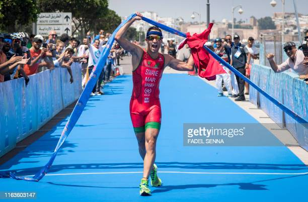 Morocco's Badr Siwane crosses the finish line during the men's final triathlon event at the 12th edition of the African Games on August 24 2019 in...