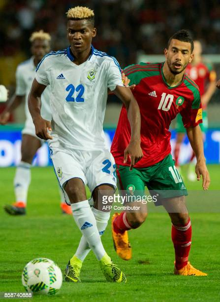 Morocco's Belhanda Younes vies for the ball with Gabon's Ndong Didier during their FIFA world Cup 2018 Group C football match between Morocco and...