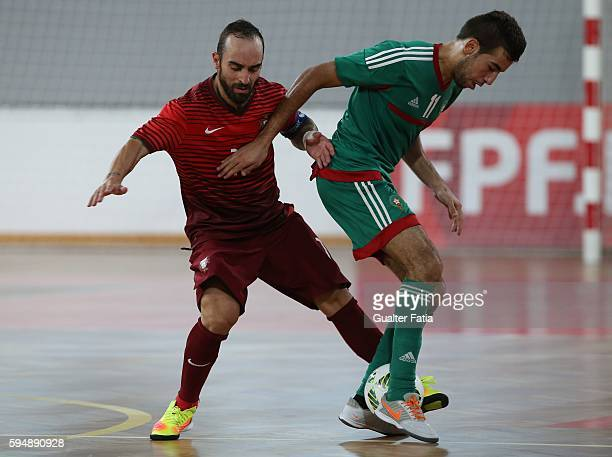 Morocco's Bilal Bakkali with Portugal's Ricardinho in action during the Futsal International Friendly match between Portugal and Morocco at Pavilhao...