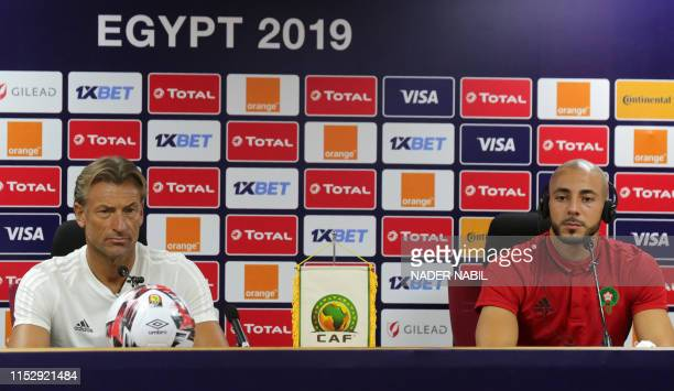 Morocco's coach Herve Renard and Morocco's forward Nordin Amrabat attend a press conference in the capital Cairo on June 30 on the eve of the 2019...