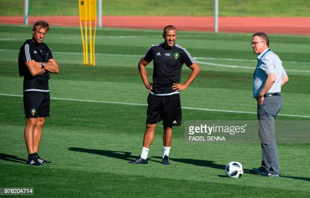 Morocco's coach Herve Renard assistant coach Mustapha Hadji and president of Morocco's Royal Football Federation Fouzi Lekjaa attend a training...
