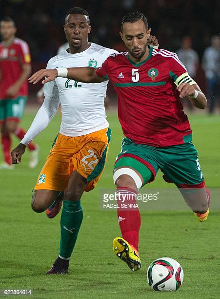 Morocco's defender and captain Mehdi Benatia vies for the ball with Ivory Coast's forward Jonathan Kodjia during the World Cup 2018 qualifier...