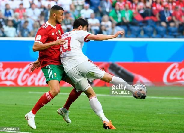 Morocco's defender Mehdi Benatia and Iran's forward Sardar Azmoun during the Russia 2018 World Cup Group B football match between Morocco and Iran at...