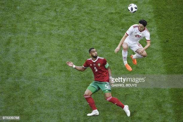 TOPSHOT Morocco's defender Mehdi Benatia vies for the ball with Iran's forward Sardar Azmoun during the Russia 2018 World Cup Group B football match...