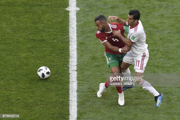 TOPSHOT Morocco's defender Mehdi Benatia vies for the ball with Iran's forward Vahid Amiri during the Russia 2018 World Cup Group B football match...