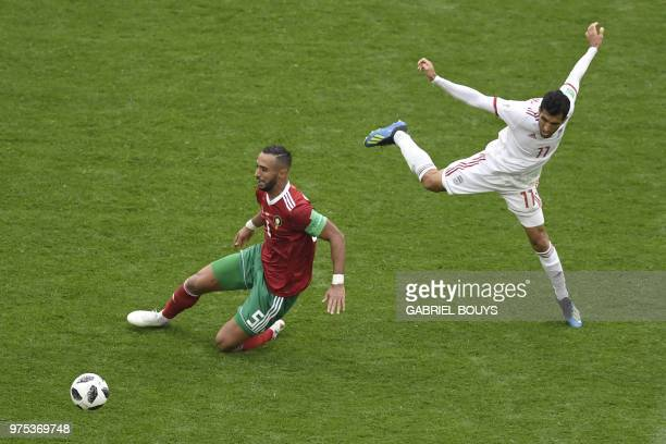 Morocco's defender Mehdi Benatia vies for the ball with Iran's forward Vahid Amiri during the Russia 2018 World Cup Group B football match between...