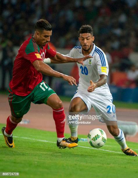 Morocco's defender Nabil Dirar marks Gabon's midfielder Denis Bouanga during their FIFA World Cup 2018 Group C football match between Morocco and...