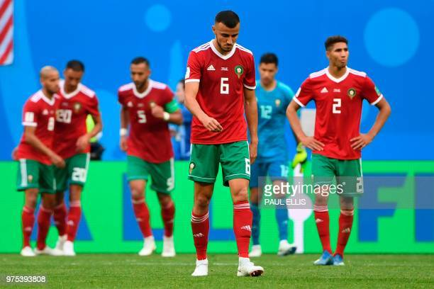 Morocco's defender Romain Saiss and his teammates react after the Russia 2018 World Cup Group B football match between Morocco and Iran at the Saint...