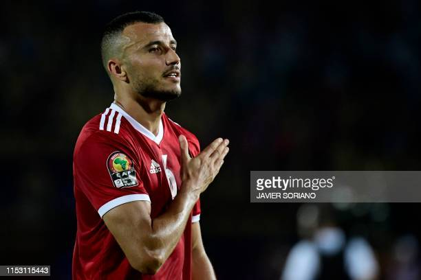 Morocco's defender Romain Saiss celebrates with the fans after the 2019 Africa Cup of Nations Group D football match between Morocco and Ivory Coast...