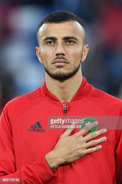 Morocco's defender Romain Saiss listens to the national anthem before the Russia 2018 World Cup Group B football match between Spain and Morocco at...